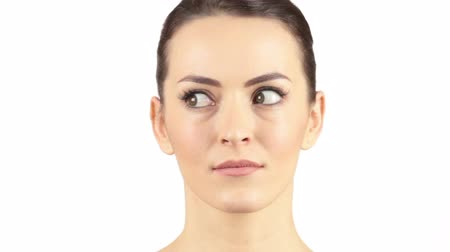 aşağı bakıyor : Attractive woman moving her eyes around in a confused manner