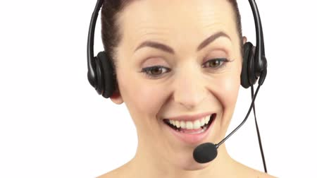 сюрприз : Attractive young woman wearing a telephone headset showing surprise and laughing Стоковые видеозаписи