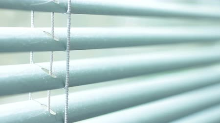 okno : Large window blinds opening showing a bright sunny day
