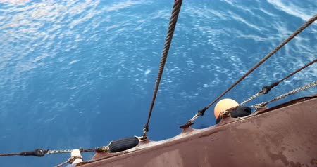 lanoví : Looking over a yacht side down into the water on a calm day in summer