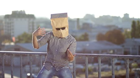 garip : Man with paper bag over head dancing