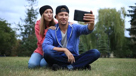 make photo : Young couple of students making selfie on tablet