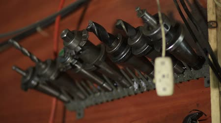 toolbox : Old tools hanging on wall in workshop Stock Footage