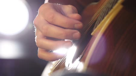 Detail of a guitarist playing classical guitar