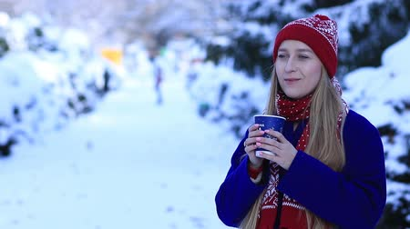 cobalt : Smiling young woman drinking coffee in cold winter