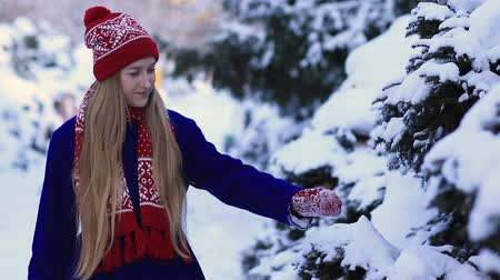 cobalt : Young woman walking in snow forest