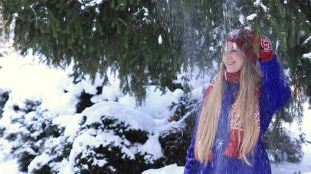 cobalt : Happy girl getting a snow shower Stock Footage