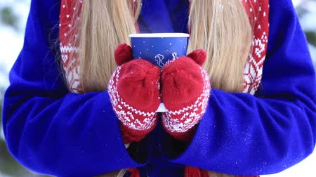 cobalt : Female hands with hot drink outdoors on winter day