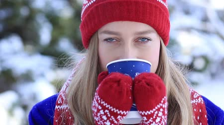 cobalt : Young woman enjoying scent of coffee in wintertime