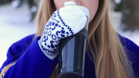 cobalt : Woman drinking hot wine from thermocup in winter