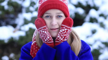 cobalt : Attractive woman freezing outdoors in winter Stock Footage
