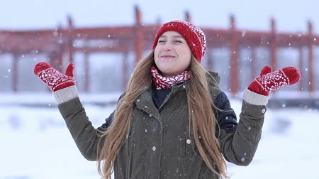 mittens : Happy young woman enjoying first snow Stock Footage