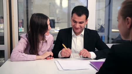 anlaşma : Happy couple signing real-estate contract Stok Video