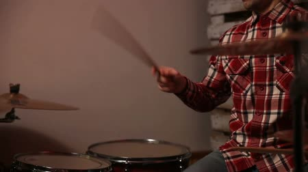 drumbeat : Expressive drummer playing drums with drum stick