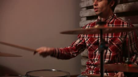 drumbeat : Attractive young man drummer playing on his kit Stock Footage