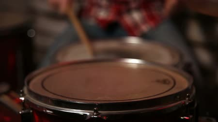 vurmalı : Drum sticks hitting the drum closeup