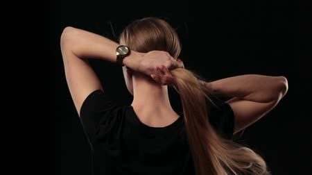 çekme : Woman holding long hair and pulling blond hair Stok Video