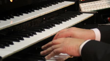 pipe organ : Organist playing 3 keyboards and pipe organ Stock Footage