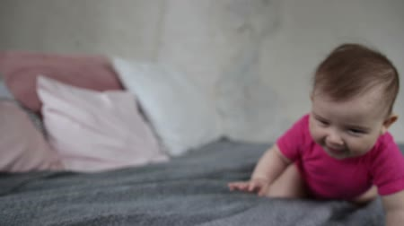 babycare : Happy baby girl crawling on bed