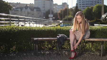 vysoký : Charming woman in high heels massaging tired legs
