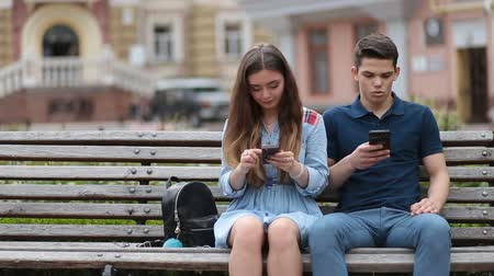 disinterest : Couple in disinterest moment with phones outdoors