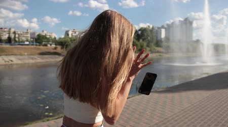 broken crash : Smartphone slipping from womans hand on street Stock Footage