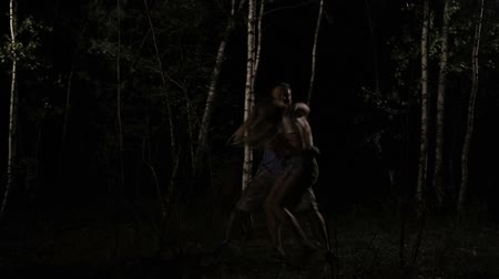jungle : Girl attacked by sexual maniac in forest at night Stock Footage