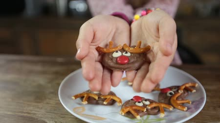 pretzel : Childs hands offering delicious homemade cookie Stock Footage