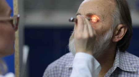 pupillary : Physician examining pupillary reflex with flashlight Stock Footage