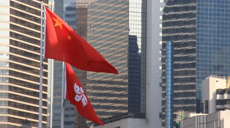 polinésia : Flags of China and Hong Kong flying in the wind Stock Footage