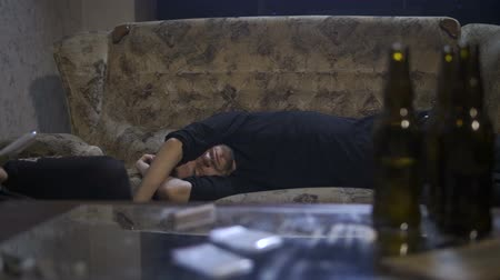 geçti : Male overdosed on the sofa at home at night Stok Video