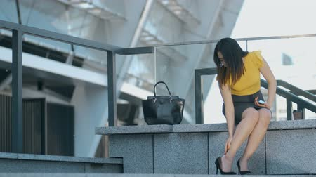high heels : Asian business woman touching aching feet Stock Footage