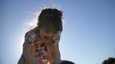 parte : Close-up mother lifting little daughter in the air Stock Footage