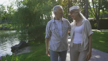 alma : Joyful mature couple taking a stroll in nature Stok Video