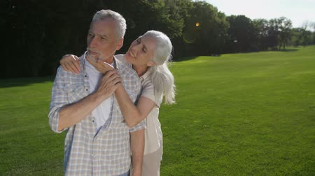 whispering : Lovely senior woman whispering husband about love