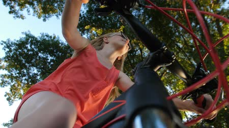Low angle of teenage girl cycling in summer Dostupné videozáznamy