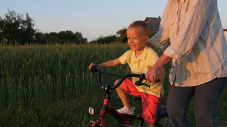 milestone : Happy first ride of little boy on bike with granny
