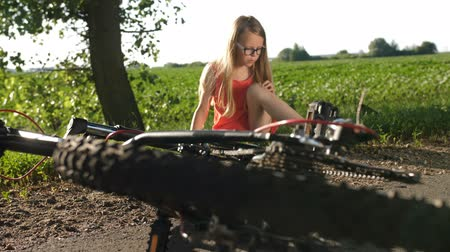 relieve : Teenage girl on road after bicycle accident Stock Footage