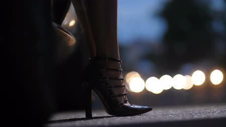 Legs in high heels stepping out of car at night Dostupné videozáznamy