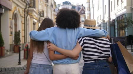 Multiracial girls embracing while shopping Stock Footage