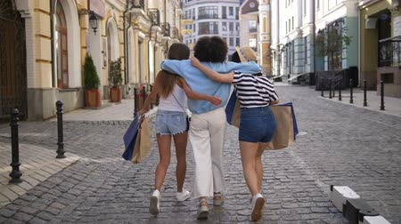 Back view of diverse fashion girls shopping Stock Footage