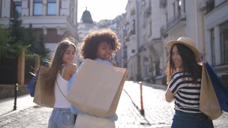 Multinational shopper girls smiling at camera Stock Footage