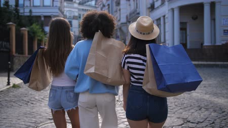 Cheerful diverse friends smiling while shopping Stock Footage