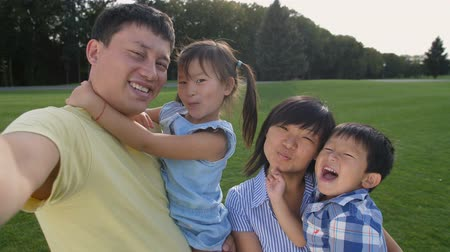 Happy asian family making self portrait on phone Stock Footage