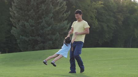 Loving asian dad playing with his lovely daughter Stock Footage