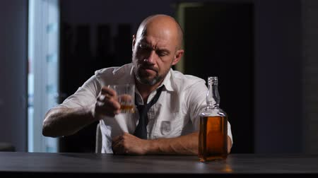 wasted : Depressed adult businessman drinking whiskey