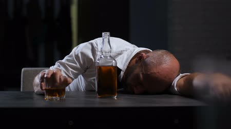 hangover : Alcoholic wasted man sleeping drunk on the table