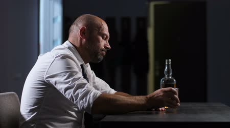 dismissal : Wasted alcoholic man drinking whiskey at home