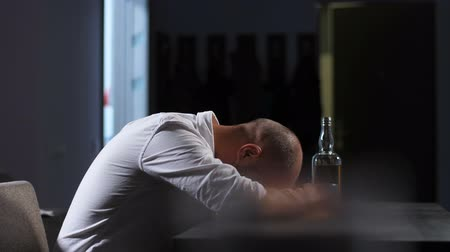 wasted : Depressed man in alcohol abuse lying on the table