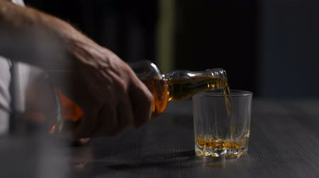 wasted : Drunk man suffering from alcoholism drinking whisky
